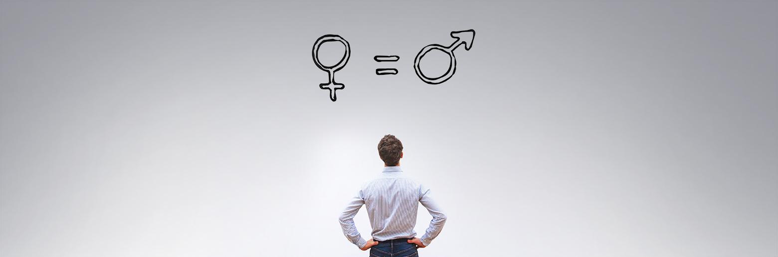 Mann ser opp på mann og kvinnesymbol